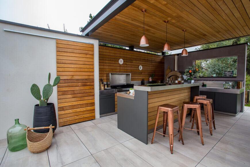 jolie cuisine extérieure couverte sur terrasse